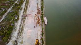 Industrial cargo port with cranes on the Danube river. Aerial view stock video footage