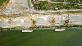 Industrial cargo port with cranes on the Danube river. Aerial view stock footage