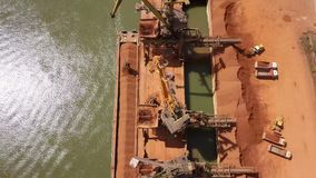 Industrial cargo port with operating cranes on the Danube river stock footage