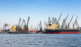 Industrial cargo ship is loading in port of Varna Royalty Free Stock Photo
