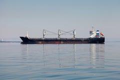 Industrial cargo ship on still sea Royalty Free Stock Photos