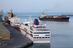 Industrial cargo ships and cruise liner at port royalty free stock image