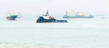Industrial cargo ships Singapore harbor royalty free stock image