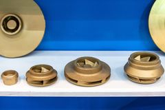 Industrial casting parts vane pump or propeller blades gold color or brass on table.  stock photo