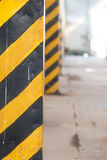 Industrial caution area - black and yellow stripes Stock Images