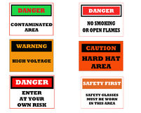 Industrial caution signs Stock Images