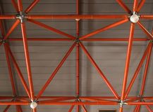 Industrial ceiling made of red iron beams stock images