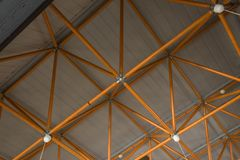 Industrial ceiling made with yellow steel girders royalty free stock image