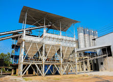 Industrial cement processing facility. With blue sky stock photography