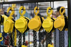 Industrial chain hoist for reduce working load and lifting heavy. Object, mechanical hoist, gear hoist for one man operation with heavy weight mold and die Royalty Free Stock Images