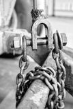 Industrial chain wrapped around a pipe Stock Images