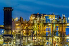 Industrial Chemical plant framework profile detail at night. Framework detail at night in a heavy Chemical Industrial plant with mazework of tubes and pipes royalty free stock image