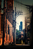 A industrial Chicago alley with the Sears Willis Tower skyscrape Stock Photo