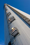 Industrial chimney 1. Close view of a tall industrial chimney from the ground up stock photography