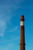 Industrial chimney without emission on blue sky background, concept for ecology safety. Stock Photos