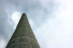 Industrial chimney emit toxic pollutants in the sky. Polluting the environment Royalty Free Stock Photography