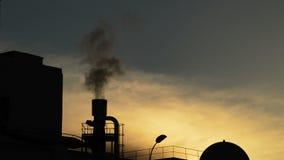 Industrial chimney exhaling smoke at sunset. Chimney or stack in plant industrial exhaling pollution smoke stock video