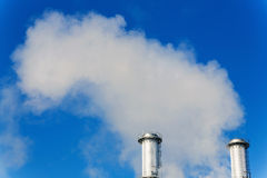 Industrial chimney with exhaust gases Stock Photography