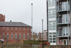 Industrial, Chimney and Flats. A view across the town showing the industrial mill, a large metal chimney and some modern flats Royalty Free Stock Photography