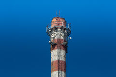 Industrial chimney with GSM relays Royalty Free Stock Photos