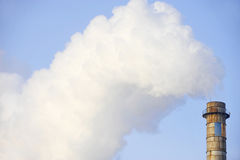 Industrial chimney with huge cloud of smoke Royalty Free Stock Photos