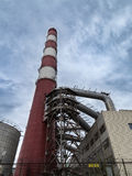 Industrial chimney. Long industrial industrial pipes as part of power plant stock images