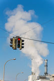 Industrial chimney and red traffic lights Stock Photos