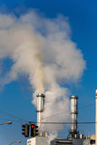 Industrial chimney and red traffic lights Stock Photo