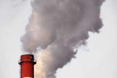 Industrial chimney releasing smog Stock Images