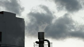 Industrial chimney or stack exhaling pollution smoke at cloudy day. Industrial chimney or stack exhaling pollution smoke in industrial plant at cloudy day at stock video footage