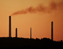 Industrial chimney stacks in landscape pollution Stock Photography