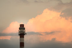 Industrial chimney in sunset Royalty Free Stock Photography