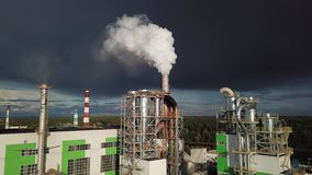 Industrial chimney urban scenery power plant pollution steam landscape stock video