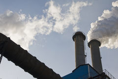 Industrial chimneys Stock Images
