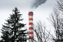 Industrial chimneys blowing dirty smoke Stock Photo