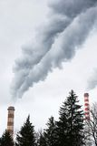 Industrial chimneys blowing dirty smoke Royalty Free Stock Photos