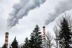 Industrial chimneys blowing dirty smoke Royalty Free Stock Image