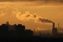 Industrial chimneys at dawn Stock Photos