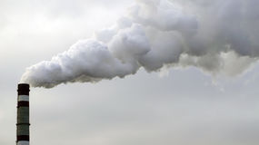 Industrial chimneys emits toxic pollutants into the sky polluting the environment. Stock Photography