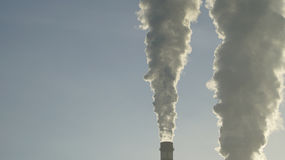 Industrial chimneys emits toxic pollutants into the sky polluting the environment. Stock Images