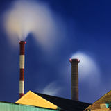 Industrial chimneys at night Stock Photography