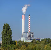 Industrial chimneys over green trees in Basel, Switzerland Stock Photos