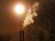 Industrial chimneys sun Royalty Free Stock Photography