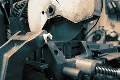 Industrial circular saw machine in a factory workshop stock photos