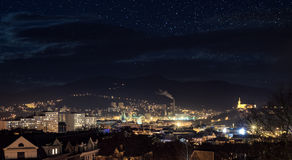 Industrial city in night with sky full of stars Stock Images