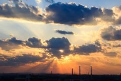 Industrial city silhouette against the sky on a sunset. Stock Photography