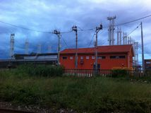 Industrial city zone. Industrial zone with orange building Stock Images