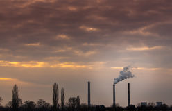 Industrial cityscape with coal power plant and smoke stacks Stock Photos
