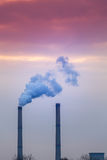 Industrial cityscape with coal power plant and smoke stacks Stock Image