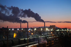 Industrial cityscape with smoke of chimneys Stock Photo